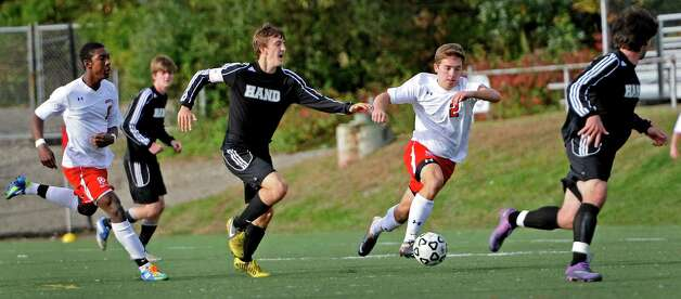 Fairfield Prep high school's Ryan Orvis moves the ball upfield in a boys soccer game against Daniel Hand high school held at Fairfield Prep, Fairfield, CT on Wednesday October 17th, 2012. Photo: Mark Conrad / Connecticut Post Freelance