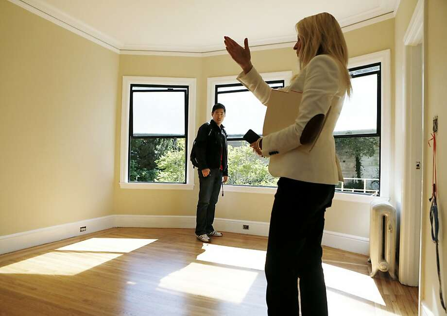 Bo Lu is shown a one bedroom Haight Street apartment by Wendy Willbanks, of She Moves You. Photo: Beck Diefenbach, Special To The Chronicle