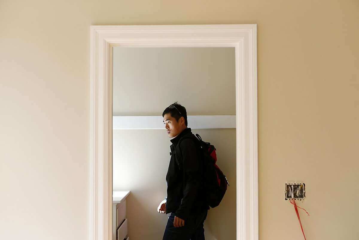 Bo Lu, of Seattle, is shown a one bedroom apartment by Wendy Willbanks, of She Moves You, at 959 Haight Street on Wednesday, October 17, 2012 in San Francisco, Calif.