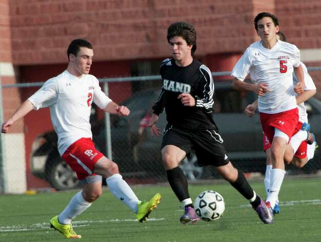 Daniel Hand high school's Gavin Reeves moves the ball up field in a boys soccer game against Fairfield Prep high school held at Fairfield Prep, Fairfield, CT on Wednesday October 17th, 2012. Photo: Mark Conrad / Connecticut Post Freelance