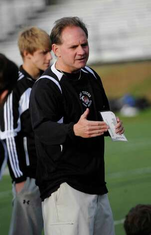 Daniel Hand high school boys soccer team head coach Stan Latkowski	talks to his team at half time during game against Fairfield Prep high school held at Fairfield Prep, Fairfield, CT on Wednesday October 17th, 2012. Photo: Mark Conrad / Connecticut Post Freelance