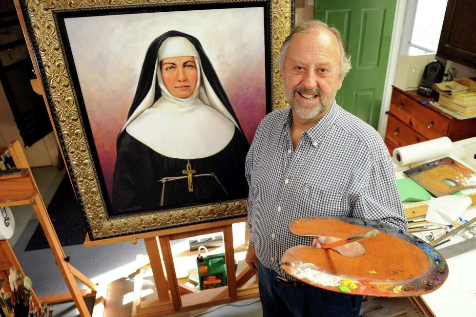 Artist Robert Francis Whelan by a giclee copy of his original painting of Saint Marianne Cope on Wednesday, Oct. 17, 2012, at his home in Valatie, N.Y. The original will be on display at St. Mary's Catholic Church in Hudson on Sunday, when the saint will be canonized. (Cindy Schultz / Times Union)