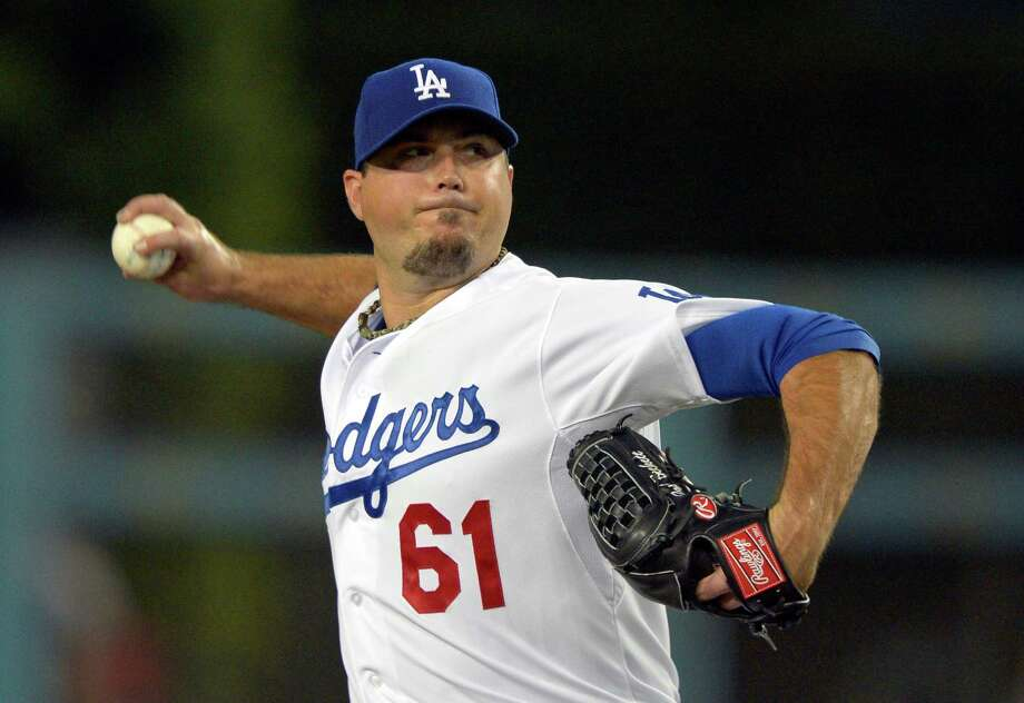 FILE - This Sept. 13, 2012 file photo shows Los Angeles Dodgers starting pitcher Josh Beckett throwing during the first inning of a baseball game against the St. Louis Cardinals in Los Angeles.  A company owned by Beckett is suing a pipeline builder claiming it destroyed the habitat of the endangered ocelot on a South Texas ranch. The lawsuit filed Tuesday in Laredo says Eagle Ford Midstream LP violated the federal Endangered Species Act by clearing land to build a natural gas pipeline. (AP Photo/Mark J. Terrill, File) Photo: Mark J. Terrill / AP