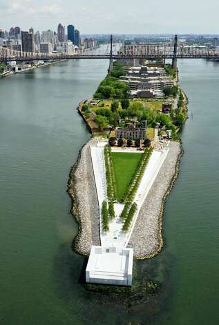 This July 11, 2012 photo provided by FDR Four Freedoms Park LLC, shows an arial view of the New York City memorial park, honoring President Franklin D. Roosevelt, that has been completed 40 years after the original design was created. The Franklin D. Roosevelt Four Freedoms Park on the southern tip of 2-mile-long Roosevelt Island  - between Manhattan and Queens -  is being dedicated Wednesday, Oct. 17, 2012, in a ceremony to be attended by dignitaries including former President Bill Clinton and Mayor Michael Bloomberg. (AP Photo/FDR Four Freedoms Park LLC, Steve Amiaga - www.amiaga.com) Photo: Steve Amiaga