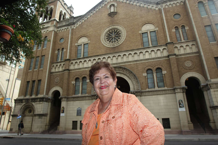 """Mary Jane Hardy stands outside St. Mary's Catholic Church. Hardy is the author of """"Spiritual Treasures of Downtown San Antonio."""" The book profiles historic churches in downtown San Antonio, and helped the author grieve her husband's death. Photo: John Davenport, San Antonio Express-News / ©San Antonio Express-News/Photo Can Be Sold to the Public"""