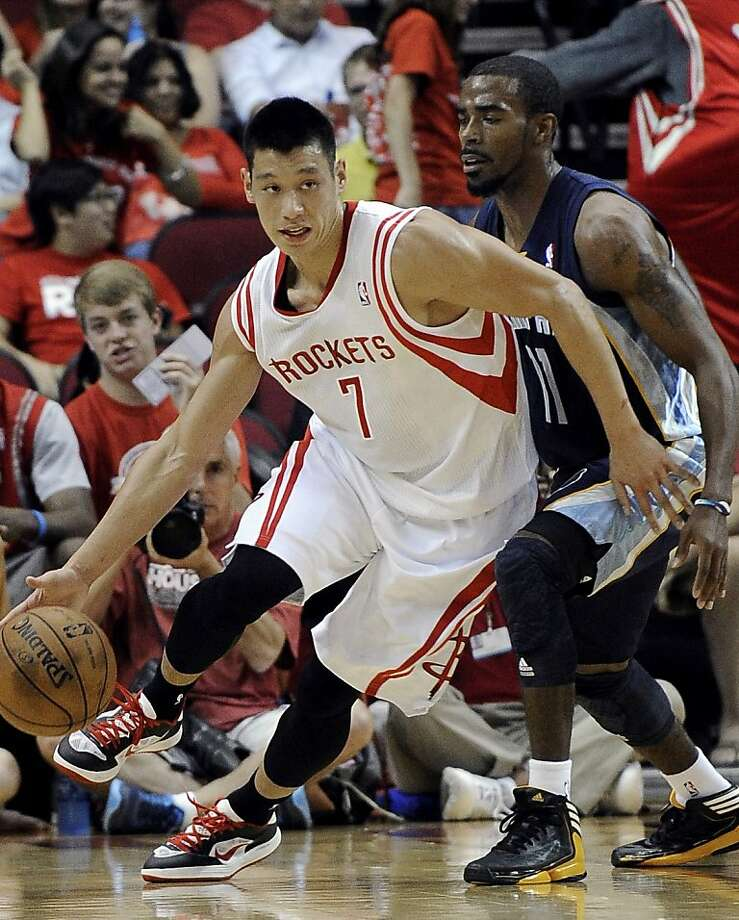 Houston Rockets' Jeremy Lin (7) drives the ball around Memphis Grizzlies' Mike Conley Jr. (11) during the first half of a preseason NBA basketball game Wednesday, Oct. 17, 2012, in Houston. (AP Photo/Pat Sullivan) Photo: Pat Sullivan, Associated Press