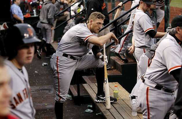 Giants' Hunter Pence wathces from the dugout as his team bats in the fourth inning, as the San Francisco Giants take on  the St. Louis Cardinals  in game three, of the National League Championship Series  which is tied at 1-1, on Wednesday Oct. 17, 2012. at Busch Stadium ,  in  St. Louis, Mo. Photo: Michael Macor, The Chronicle