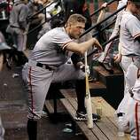 Giants' Hunter Pence wathces from the dugout as his team bats in the fourth inning, as the San Francisco Giants take on  the St. Louis Cardinals  in game three, of the National League Championship Series  which is tied at 1-1, on Wednesday Oct. 17, 2012. at Busch Stadium ,  in  St. Louis, Mo.
