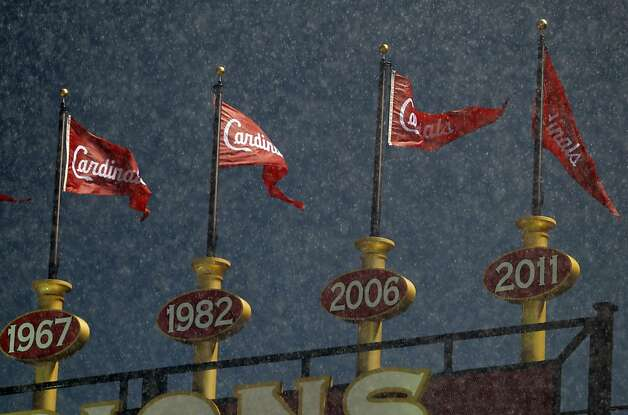 The Cardinals championship banners wave in the wind-driven rain as the game is delayed due to the heavy storm passing through the area. The San Francisco Giants played the St. Louis Cardinals in Game 3 of the National League Championship Series at Busch Stadium on Wednesday, October 17, 2012, in St. Louis, Mo. Photo: Carlos Avila Gonzalez, The Chronicle