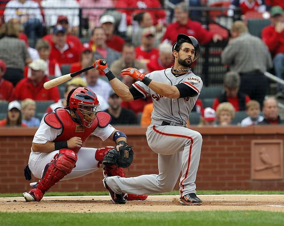 Angel Pagan's helmet almost comes off as he swings through strike three in the top of the first inning. The San Francisco Giants played the St. Louis Cardinals in Game 3 of the National League Championship Series at Busch Stadium on Wednesday, October 17, 2012, in St. Louis, Mo. Photo: Carlos Avila Gonzalez, The Chronicle