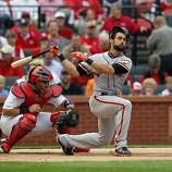 Angel Pagan's helmet almost comes off as he swings through strike three in the top of the first inning. The San Francisco Giants played the St. Louis Cardinals in Game 3 of the National League Championship Series at Busch Stadium on Wednesday, October 17, 2012, in St. Louis, Mo.