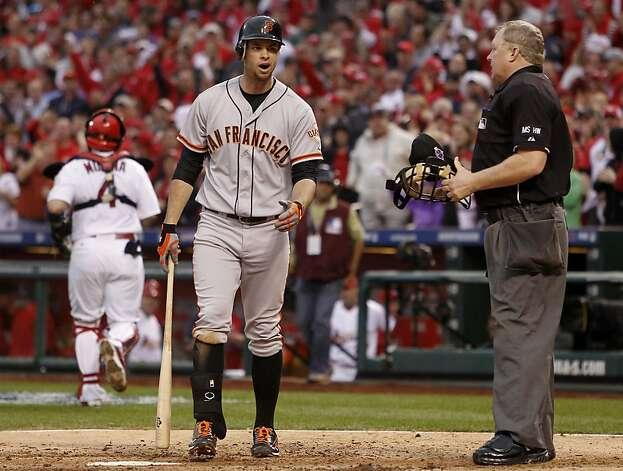 GIants' Brandon Belt argues a called strike three to end the seventh inning with two runners on, with home plate umpire Bill Miller, as the San Francisco Giants take on the St. Louis Cardinals in game three, of the National League Championship Series  which is tied at 1-1, on Wednesday Oct. 17, 2012. at Busch Stadium ,  in  St. Louis, Mo. Photo: Michael Macor, The Chronicle