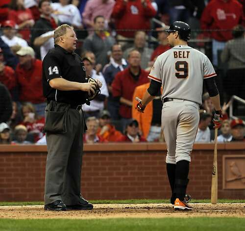 Brandon Belt talks to homeplate umpire Bill Miller about a strike call after Belt struck out looking in the seventh. The San Francisco Giants played the St. Louis Cardinals in Game 3 of the National League Championship Series at Busch Stadium on Wednesday, October 17, 2012, in St. Louis, Mo. Photo: Carlos Avila Gonzalez, The Chronicle