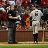 Brandon Belt talks to homeplate umpire Bill Miller about a strike call after Belt struck out looking in the seventh. The San Francisco Giants played the St. Louis Cardinals in Game 3 of the National League Championship Series at Busch Stadium on Wednesday, October 17, 2012, in St. Louis, Mo.