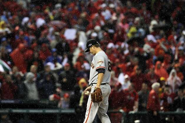 Giants pitcher Matt Cain waits on the mound as Manager Bruce Bochy approaches to relieve him after the Cardinals scored a run in the seventh. The San Francisco Giants played the St. Louis Cardinals in Game 3 of the National League Championship Series at Busch Stadium on Wednesday, October 17, 2012, in St. Louis, Mo. Photo: Carlos Avila Gonzalez, The Chronicle