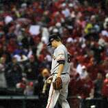 Giants pitcher Matt Cain waits on the mound as Manager Bruce Bochy approaches to relieve him after the Cardinals scored a run in the seventh. The San Francisco Giants played the St. Louis Cardinals in Game 3 of the National League Championship Series at Busch Stadium on Wednesday, October 17, 2012, in St. Louis, Mo.