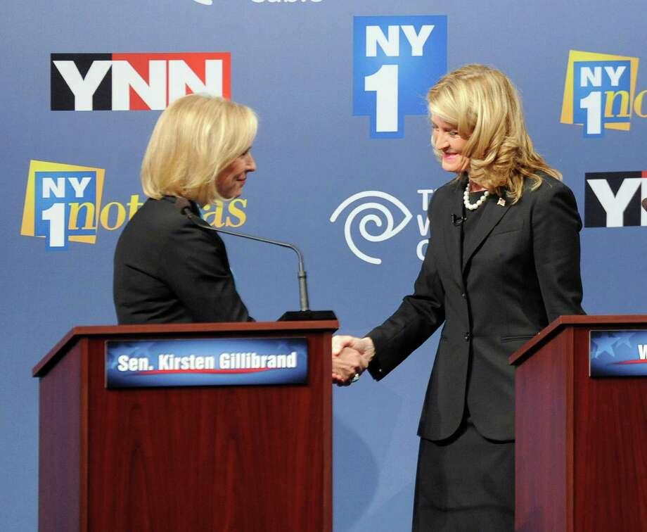 Sen. Kirsten Gillibrand, D-N.Y., left, and Republican challenger Wendy Long shake hands before their debate at Skidmore College in Saratoga Springs, N.Y. on Wednesday, Oct. 17, 2012. (AP Photo/Tim Roske, Pool) Photo: Tim Roske