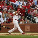 Matt Carpenter watches the flight of his two-run homerun in the third inning. The San Francisco Giants played the St. Louis Cardinals in Game 3 of the National League Championship Series at Busch Stadium on Wednesday, October 17, 2012, in St. Louis, Mo.