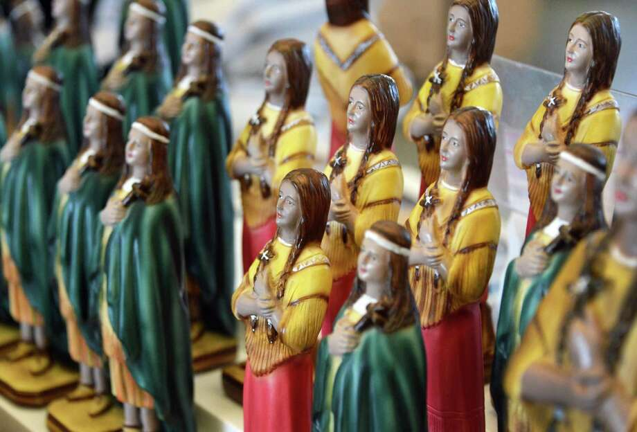 Kateri Tekakwitha figurines for sale in the gift shop at the Shrine of Our Lady of Martyrs in Auriesville Wednesday Oct. 17, 2012.  Kateri  will be  canonization at the Vatican in Rome Sunday.(John Carl D'Annibale / Times Union) Photo: John Carl D'Annibale / 00019706A