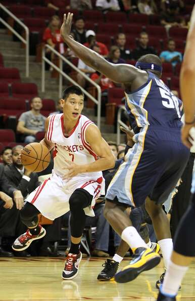 Houston's Jeremy Lin (7) with the ball during the first half of an NBA preseason game at Toyota Cent