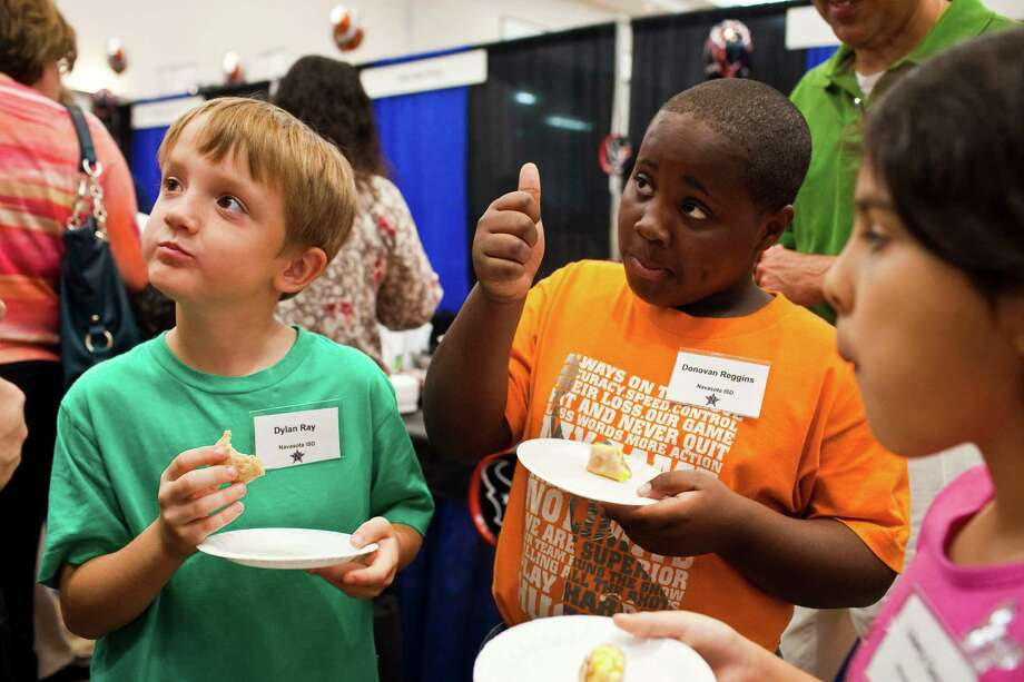 "Dylan Ray, 8, left, Donovan Reggins, 9, and Liberty Garza, 8, judge their food as ""good"" during the Annual Choice Partners Food Expo Oct. 17, 2012 in Humble at the Humble Civic Center. Food directors and students from 50 area schools sampled food from commodity food vendors. The event was hosted by the Harris County Department of Education. Photo: Eric Kayne, For The Chronicle / © 2012 Eric Kayne"