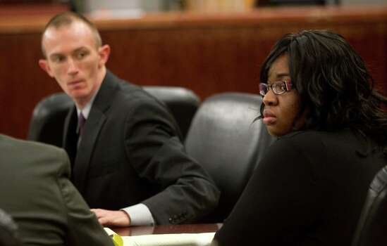 Jessica Tata, right, sits with Bryan Garris, left, during pretrial motions in the 180th District Court Wednesday, Oct. 17, 2012, in Houston. Tata is accused in the deaths of four children at her home day care in 2011. Authorities believe she left the children alone while she went shopping and the fire was ignited by a stove-top burner left on. Photo: Cody Duty, Houston Chronicle / © 2012 Houston Chronicle