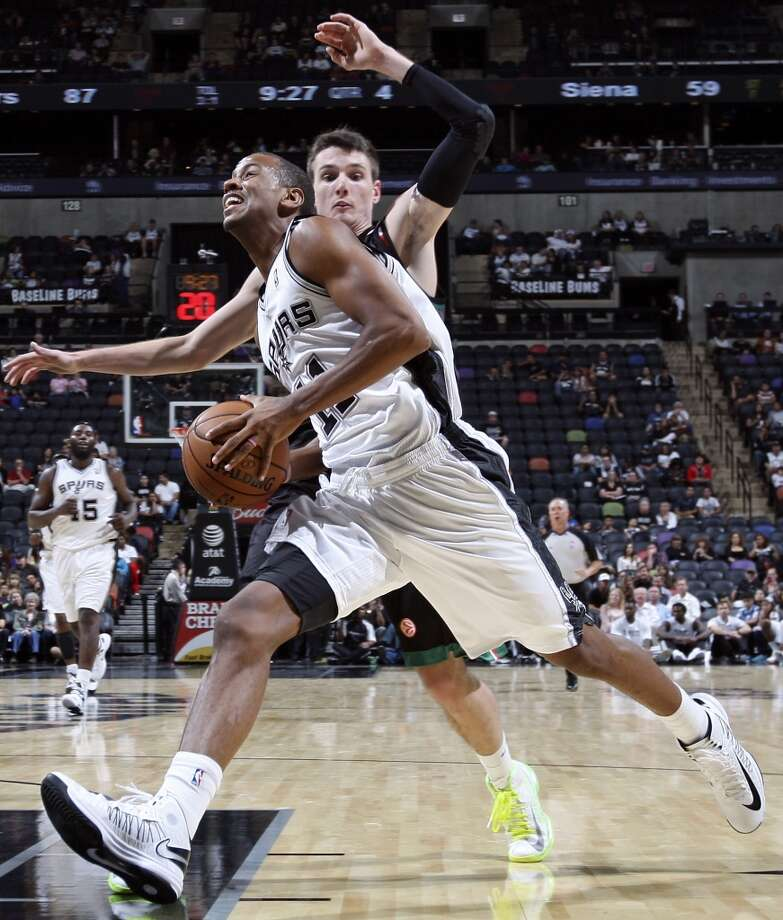 The Spurs' Wesley Witherspoon drives around Montepaschi Siena's Matt Janning during second half action Saturday, Oct. 6, 2012, at the AT&T Center. The Spurs won 106-77. (Edward A. Ornelas / San Antonio Express-News)