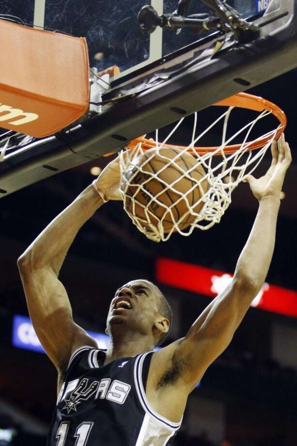 The Spurs' Wesley Witherspoon (11) scores against the Houston Rockets during the second half of an NBA basketball game, Sunday, Oct. 14, 2012, in Houston. The Spurs won 116-107.