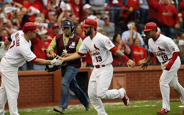 Matt Carpenter is congratulated by Matt Holliday, left, after Carpenter hit a two-run homerun in the third inning.  Jon Jay, right, was on base at the time and scored on the homerun. The San Francisco Giants played the St. Louis Cardinals in Game 3 of the National League Championship Series at Busch Stadium on Wednesday, October 17, 2012, in St. Louis, Mo. Photo: Carlos Avila Gonzalez, The Chronicle
