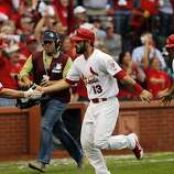 Matt Carpenter is congratulated by Matt Holliday, left, after Carpenter hit a two-run homerun in the third inning.  Jon Jay, right, was on base at the time and scored on the homerun. The San Francisco Giants played the St. Louis Cardinals in Game 3 of the National League Championship Series at Busch Stadium on Wednesday, October 17, 2012, in St. Louis, Mo.