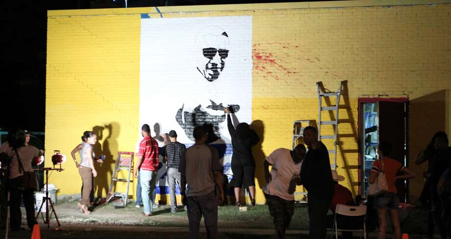 Adams and his volunteers traced the projection with markers and painted