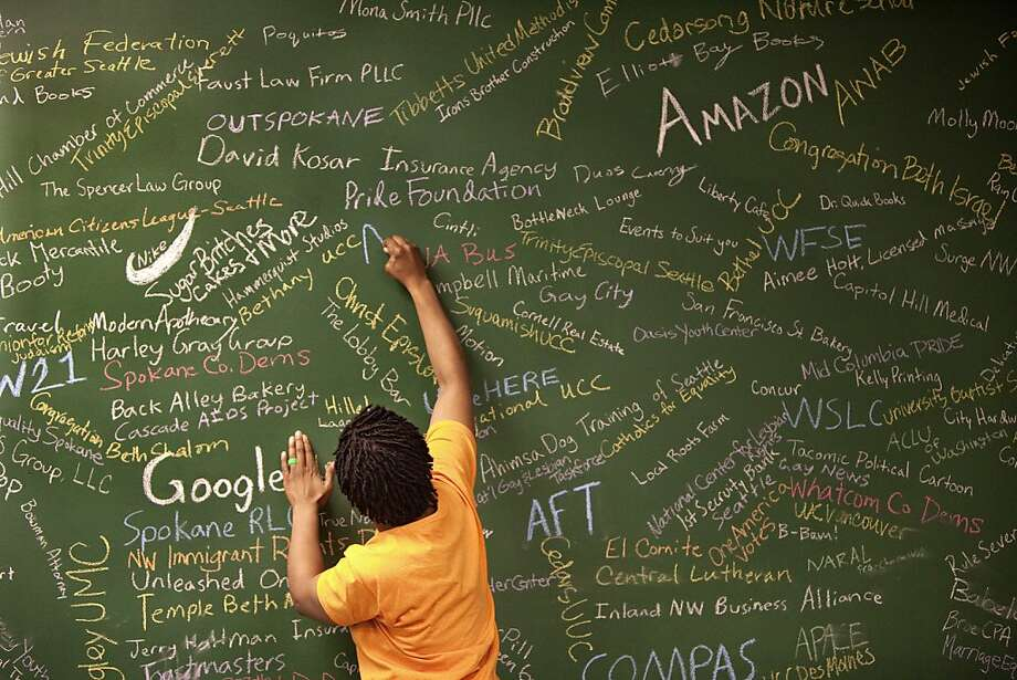 Sylvia Rolle, social-media director for Washington United for Marriage, lists supporters on an endorsement wall. Photo: Steve Ringman, McClatchy-Tribune News Service