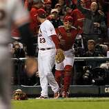 David Freese congratulates Yadier Molina after Molina caught a foul ball hit by Aubrey Huff for the final out in the eighth inning. The San Francisco Giants played the St. Louis Cardinals in Game 3 of the National League Championship Series at Busch Stadium on Wednesday, October 17, 2012, in St. Louis, Mo.