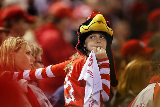 A young Cardinals fan watches in the final inning at Busch Stadium as the Cardinals beat the Giants 3-1. The San Francisco Giants played the St. Louis Cardinals in Game 3 of the National League Championship Series at Busch Stadium on Wednesday, October 17, 2012, in St. Louis, Mo. Photo: Carlos Avila Gonzalez, The Chronicle