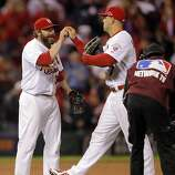 Jason Motte, left, and Matt Holliday, right, celebrate after winning the game against the Giants 3-1. The San Francisco Giants played the St. Louis Cardinals in Game 3 of the National League Championship Series at Busch Stadium on Wednesday, October 17, 2012, in St. Louis, Mo.
