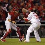 Jason Motte, right, and Yadier Molina, left, celebrate after winning the game against the Giants 3-1. The San Francisco Giants played the St. Louis Cardinals in Game 3 of the National League Championship Series at Busch Stadium on Wednesday, October 17, 2012, in St. Louis, Mo.