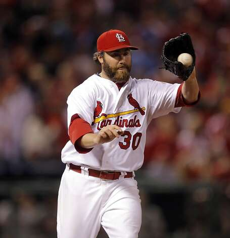 Cardinals pitcher,  Jason Motte takes the feed from first baseman Matt Chambers on a Marco Scutaro grounder for the second out of the ninth inning. The San Francisco Giants played the St. Louis Cardinals in Game 3 of the National League Championship Series at Busch Stadium on Wednesday, October 17, 2012, in St. Louis, Mo. Photo: Carlos Avila Gonzalez, The Chronicle
