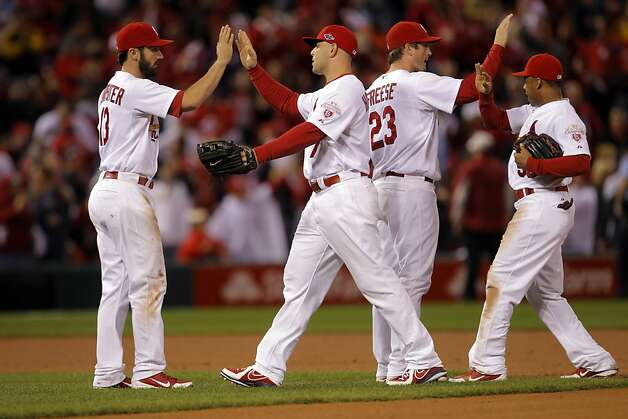 The Cardinals celebrate after defeating the Giants 3-1. The San Francisco Giants played the St. Louis Cardinals in Game 3 of the National League Championship Series at Busch Stadium on Wednesday, October 17, 2012, in St. Louis, Mo. Photo: Carlos Avila Gonzalez, The Chronicle