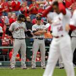 Ryan Theriot, center, watches as his former teammates on the Cardinals, are introduced at the beginning of the game. The San Francisco Giants played the St. Louis Cardinals in Game 3 of the National League Championship Series at Busch Stadium on Wednesday, October 17, 2012, in St. Louis, Mo.