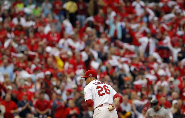 Kyle Lohse pitches in the sixth inning as fans wave their rally towels. The San Francisco Giants played the St. Louis Cardinals in Game 3 of the National League Championship Series at Busch Stadium on Wednesday, October 17, 2012, in St. Louis, Mo. Photo: Carlos Avila Gonzalez, The Chronicle