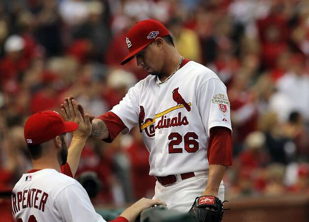 Kyle Lohse high fives teammates after being relieved in the sixth inning. The San Francisco Giants played the St. Louis Cardinals in Game 3 of the National League Championship Series at Busch Stadium on Wednesday, October 17, 2012, in St. Louis, Mo. Photo: Carlos Avila Gonzalez, The Chronicle