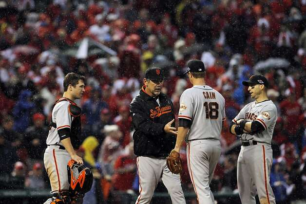 Giants Manager Bruce Bochy relieves Matt Cain in the seventh inning, moments before the game was officially delayed due to rain. The San Francisco Giants played the St. Louis Cardinals in Game 3 of the National League Championship Series at Busch Stadium on Wednesday, October 17, 2012, in St. Louis, Mo. Photo: Carlos Avila Gonzalez, The Chronicle