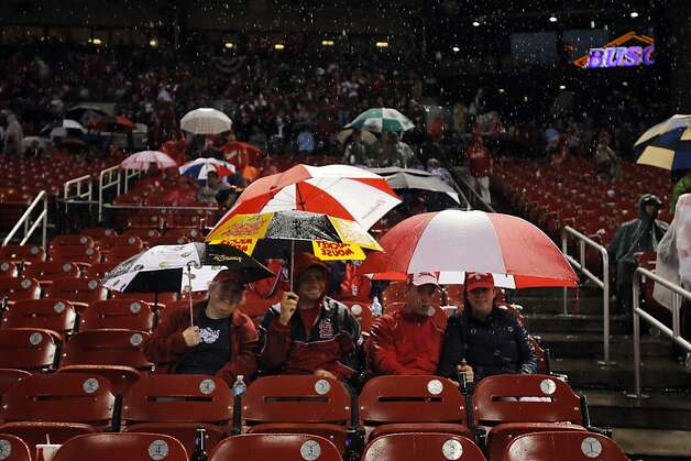Cardinals fans wait out the rain after the game was delayed by a storm on Wednesday. The San Francisco Giants played the St. Louis Cardinals in Game 3 of the National League Championship Series at Busch Stadium on Wednesday, October 17, 2012, in St. Louis, Mo. Photo: Carlos Avila Gonzalez, The Chronicle
