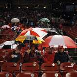 Cardinals fans wait out the rain after the game was delayed by a storm on Wednesday. The San Francisco Giants played the St. Louis Cardinals in Game 3 of the National League Championship Series at Busch Stadium on Wednesday, October 17, 2012, in St. Louis, Mo.
