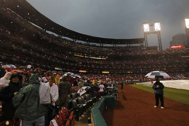 Cardinals fans move out of the rain as the game was delayed by a storm that was passing through the area. The San Francisco Giants played the St. Louis Cardinals in Game 3 of the National League Championship Series at Busch Stadium on Wednesday, October 17, 2012, in St. Louis, Mo. Photo: Carlos Avila Gonzalez, The Chronicle