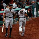 ST LOUIS, MO - OCTOBER 17:  Angel Pagan #16 of the San Francisco Giants is congratulated by Hunter Pence #8  in front of the dugout after scoring on a fielder's choice hit by Pablo Sandoval #48 of the San Francisco Giants in the third inning against the St. Louis Cardinals in Game Three of the National League Championship Series at Busch Stadium on October 17, 2012 in St Louis, Missouri.  (Photo by Kevin C. Cox/Getty Images)