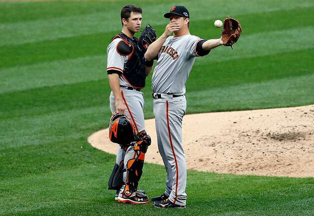 ST LOUIS, MO - OCTOBER 17:  Catcher Buster Posey #28 and pitcher Matt Cain #18 of the San Francisco Giants talk on the mound in the third inning against the St. Louis Cardinals in Game Three of the National League Championship Series at Busch Stadium on October 17, 2012 in St Louis, Missouri.  (Photo by Kevin C. Cox/Getty Images) Photo: Kevin C. Cox, Getty Images