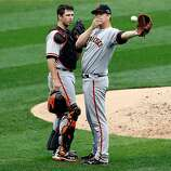 ST LOUIS, MO - OCTOBER 17:  Catcher Buster Posey #28 and pitcher Matt Cain #18 of the San Francisco Giants talk on the mound in the third inning against the St. Louis Cardinals in Game Three of the National League Championship Series at Busch Stadium on October 17, 2012 in St Louis, Missouri.  (Photo by Kevin C. Cox/Getty Images)
