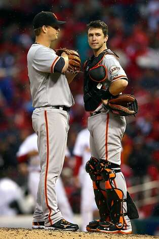 ST LOUIS, MO - OCTOBER 17:  Matt Cain #18 talks with catcher Buster Posey #28 of the San Francisco Giants in the seventh inning against the St. Louis Cardinals in Game Three of the National League Championship Series at Busch Stadium on October 17, 2012 in St Louis, Missouri.  (Photo by Elsa/Getty Images) Photo: Elsa, Getty Images