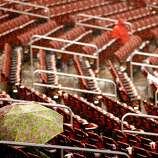 ST LOUIS, MO - OCTOBER 17:  A few fans sit in their seat during a rain delay in the seventh inning in Game Three of the National League Championship Series between the Cardinals and the San Francisco Giants at Busch Stadium on October 17, 2012 in St Louis, Missouri.  (Photo by Kevin C. Cox/Getty Images)